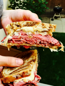 A hot, melty reuben sandwich..because why NOT throw your sandwiches on the grill??